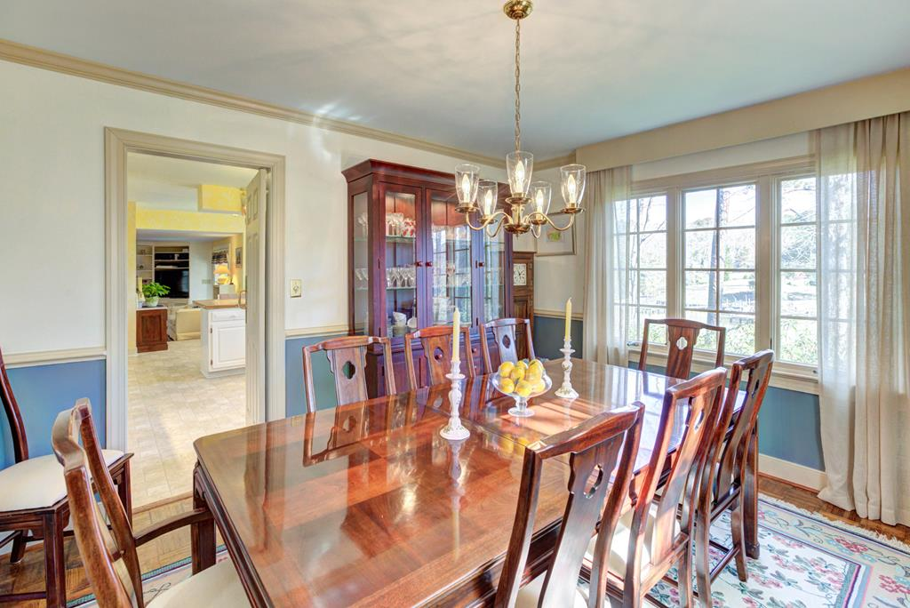 Formal dining w/parquet floors, large windows.